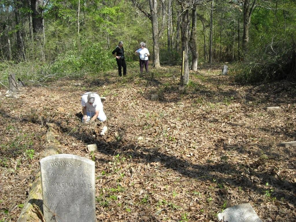 This is a photo of Bill Marsalis, Pam Wixon, and Marian Marsalis at the Marsalis Cemetery on March 20th, 2009